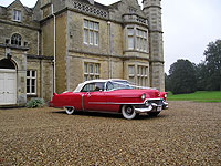 Classic American Red & white Cadillac hire